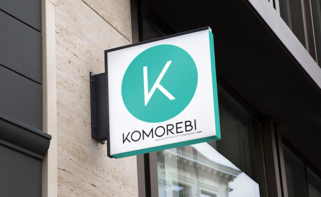Proposition d'enseigne Komorebi : le K dans un rond vert d'eau